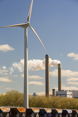 Wind turbine with stacks of coal fired power station in Amsterdam, Netherlands. May 2013