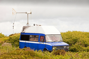 Camper van with a wind turbine used to power a computer and other electrical equipment near Zennor, Cornwall, UK. June 2010