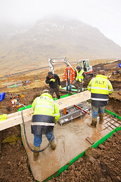 Cement being pumped into the foundations in initial groundworks for 3 wind turbines, Kirkstone Pass, Lake District, England, UK.  February 2012.