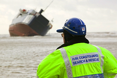 Coast guard looking at the 'Riverdance' washed ashore off Blackpool.  The 'Riverdance' was one of 3 ships lost in one day off the coast of the UK. The ship was hit by a huge wave that shifted the vehi...