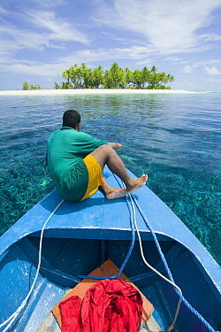 Man in boat in Funafuti Atoll, Tuvalu. MArch 2007. This area is low lying and very susceptable to sea level rise.