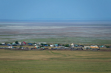 A village on the shores of the dried basin of Lake Zun-Torey, Daurian Nature Reserve. Daurian Steppes UNESCO World Heritage Site, Zabaykalsky Krai, Siberia, Russia, June 2016.