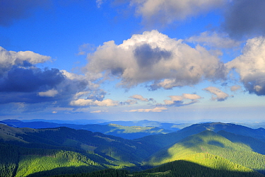 Clouds casting shadow over the Leota mountain range, Arges County, Carpathian Mountains, Romania, July