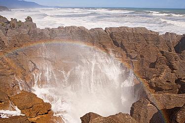 Pancake Rocks and blowholes, with rainbow, and limestone formations, Paparoa National Park, Punakaiki, New Zealand, October 2010.