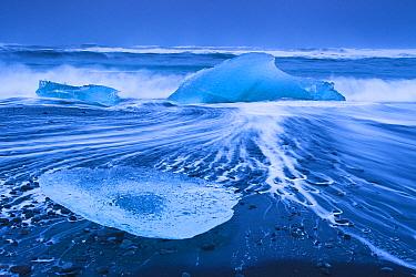 Ice washed up on Jokulsarlon, glacial lagoon, Skaftafell National Park, Iceland, February.