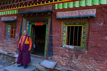 Tibetan monk and guardian of the Meditation cave of Padmasambhava, enroute to the waterfall near Yubeng, Meili Snow Mountain National park, Yunnan, China, October 2017.