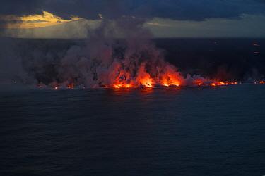 River of lava entering the ocean at dusk. Ahalanui, Kapoho, Hawaii. This lava erupted from fissure 8 of the Kilauea Volcano, near Pahoa, Hawaii. June 2018.