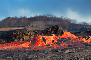 'Lava boat' or 'Lavaberg' (large chunk of partially hardened lava) floats down the lava river flowing through Kapoho, from Fissure 8 of the Kilauea Volcano, Puna District, Hawaii. June 2018.