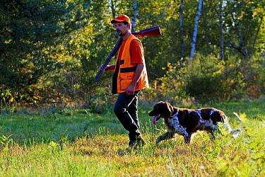 Hunter with dog, France.