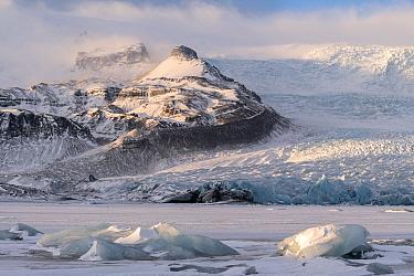 Morning light at Fjallsarlon, an iceberg lagoon at the south end of the glacier Vatnajokull, Iceland. December.