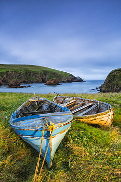 Boats on shore with Muckle Sound in background, Scousburgh, Shetland, Shetland Islands, Scotland, UK. July, 2014.