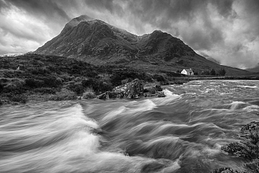 River Etive with isolated cottage beneath Buachaille Etive Mor, Rannoch Moor, Glen Coe, Highlands, Scotland, UK. November, 2013.