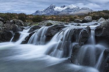 Waterfall with Black Cuillin in background, Sligachan, Isle of Skye, Inner Hebrides, Scotland, UK. January 2014.