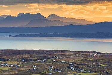 Village of Staffin with view across the Sound of Raasay. Trottenish Peninsula, Isle of Skye, Inner Hebrides, Scotland, UK. January 2014.