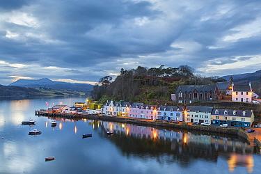 Coastal cottages at twilight, Portree, Isle of Skye, Inner Hebrides, Scotland, UK. January 2014.