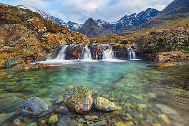 Fairy Pools with Black Cuillin mountains in background, Isle of Skye, Inner Hebrides, Scotland, UK. January 2014.
