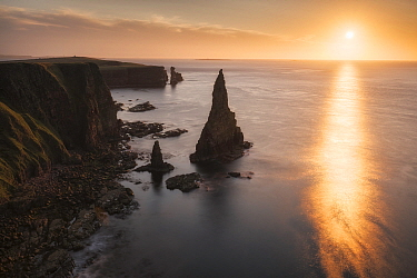Duncansby Stacks and Duncansby Head with Orkney Islands in distance, John O'Groats, Caithness, Scotland, UK. August 2014.