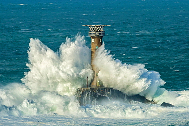 Waves crashing against Longships Lighthouse, Land's End, Cornwall, England, UK. February 2015.