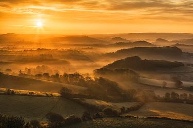 Sunrise over the Marshwood Vale, West Dorset from Quar Hill, Chideock, Dorset, England, UK. May 2013.