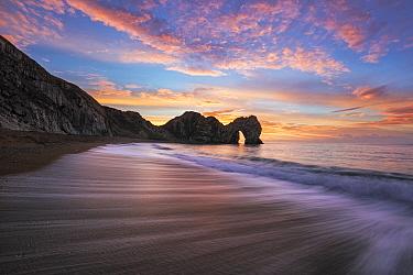 Durdle Door at sunrise, Jurassic Coast, Dorset, England, UK. December 2014.