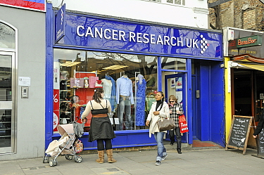 Women leaving Cancer Research UK charity shop, Upper Street, London Borough of Islington, London, England, UK, March 2009