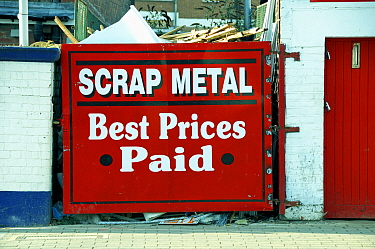 Scrap Metal Yard behind red painted gate Highbury, London Borough of Islington, UK