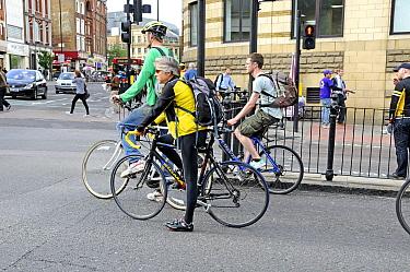Commuter cyclists held up at traffic lights, Angel, London Borough of Islington, England UK, May 2009