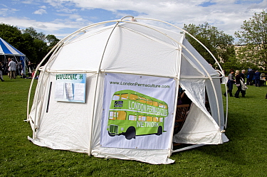 London Permaculture Network on green bus with Transition as it's destination printed on side of tent at London Green Fair (previously Camden Green Fair) England UK, June 2012