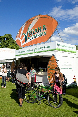Vegan & Vegetarian Food Stall with people and a bicycle around, London Green Fair (previously Camden Green Fair) Regent's Park, England UK, June 2012