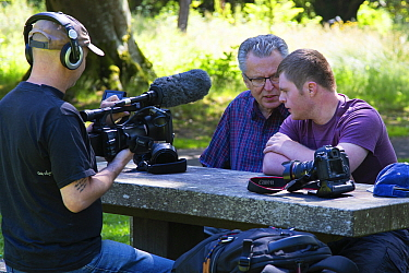 Photographers Oliver Hellowell and Ken Jenkins (Tennessee based photographer) being interviewed on film for the BBC program The One Show. Balloch Castle, Loch Lomond, Scotland, UK. July 2018