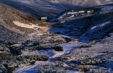 Disused manganese mine in snowy valley. The Lecht, Tomintoul, Moray, Scotland.