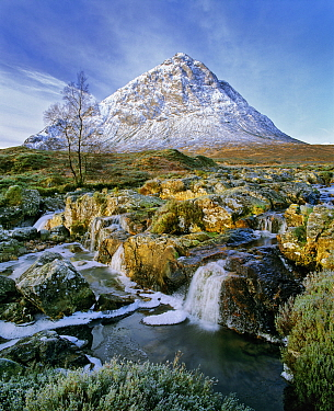Snow-capped Buchaille etive mor behind moorland and an iced-over stream that drains into Glencoe. Glen Etive, Glencoe, Highlands, Scotland.