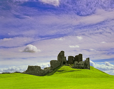 Ruin of Duffus Castle on a mound of green grass in summer. Duffus, Moray, Scotland.