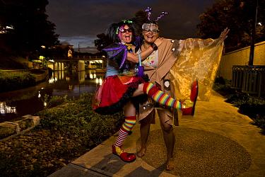Park ranger Niki Lake poses as 'Batty the Clown' alongside her friend 'Ellie the Moth' in San Antonio where a bachelor colony of Mexican free-tailed bats (Tadarida brasiliensis) live under the bridge....