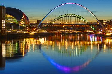 Millennium Bridge illuminated at dusk, River Tyne, Newcastle, Tyne and Wear, England, UK, December 2012.