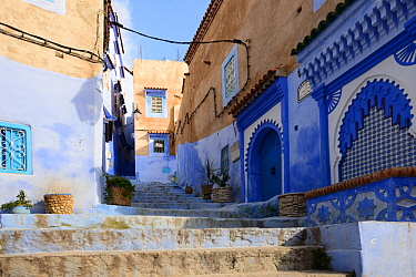 Alleyway between buildings in Chefchaouen, known as The Blue Pearl of Morocco, Chefchaouen Province, Morocco. April 2018.