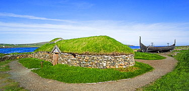 Reconstruction of Norse Viking longhouse and the Skidbladner, a full size replica of Gokstad ship at Brookpoint, Unst, Shetland Islands, Scotland, UK, May 2018