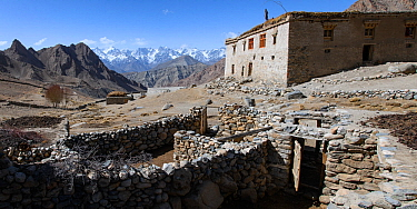High valley homestead and unprotected sheep / domestic stock pen. Ulley Valley, Himalayas, Ladakh, northern India.