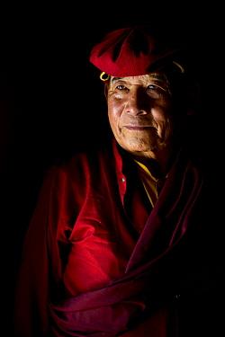 Portrait of a Buddhist Lama / teacher in traditional costume, Hemis Buddhist Monastery, India. September 2018.