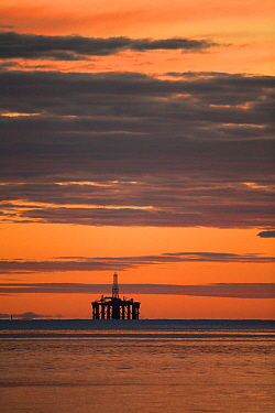 Oil rig sihouetted at dawn. Moray Firth, Scotland, UK.
