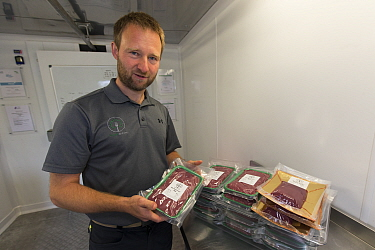 Owner of wild venison business, Forest to Fork, with meat products. Culbokie, Ross and Cromarty, Scotland, UK.