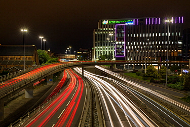 Light trails from car lights, evening rush hour in Glasgow city centre. Scotland, UK.