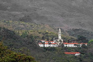 Church and buildings surrounded by Cerrado forest. Parque do Caraca, Minas Gerais, Brazil. 2010.