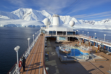 Cruise ship in front of snow covered mountains, Paradise Bay, Antarctica, January.