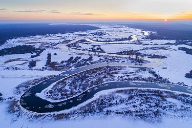Winter sunrise over freezing Suur Emajogi River. Alam-Pedja Nature Reserve, Tartumaa, Southern Estonia. January 2018.