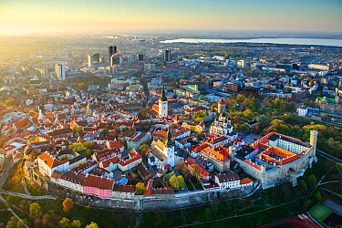 Tallinn city wall and old town, UNESCO World Heritage Site. New town and Lake Ulemiste beyond. In evening light. Harjumaa, Estonia. May 2011.