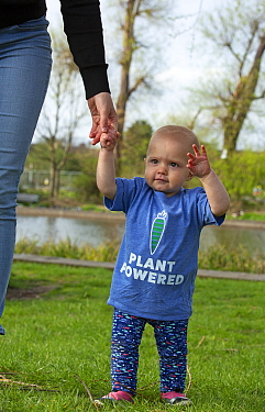Baby girl in 'plant powered' t-shirt. Model released.