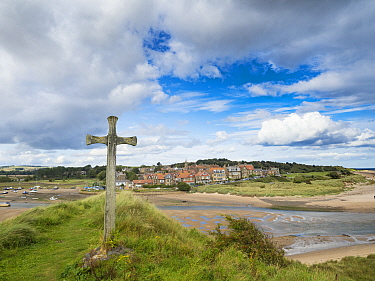Cross on bank overlooking Alnmouth Village, Northumberland, England, UK. September 2017.