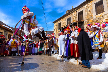 Man leaping over stick in traiditional costume, Carnival of Zamarrones, Belmonte village, Polaciones valley, Cantabria, Spain.