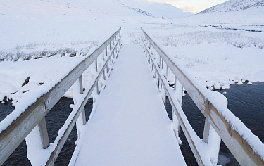 Walking the Affric Kintail Way long distance footpath in winter, River Afrric, Glen Affric, Scotland, UK, December.